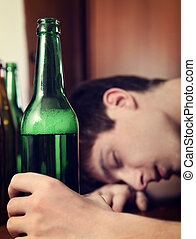 Man sleep with the Beer - Toned Photo of Young Man sleep...
