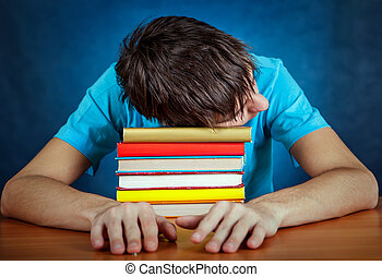 Tired Student with a Books - Tired Young Man sleep on the...