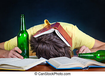 Student sleep with a Beer - Student with the Beer sleep on...