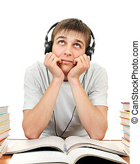 Student in Headphones listen to the Music