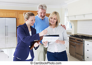 Realtor Showing Couple Around House