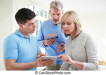 Security Consultant Demonstrating Alarm System To Mature...