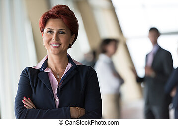 portrait of red hair senior business woman - redhair senior...