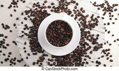 Morning coffee. Coffee magic. Roasted coffee beans turn into...