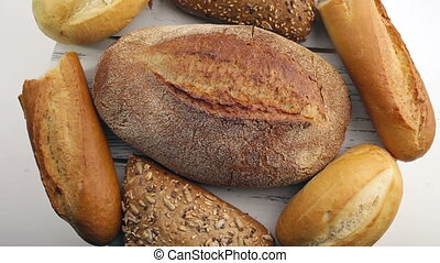 Bread in the rotating basket on a table. Loop