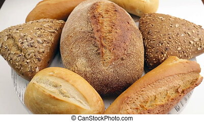 Bread in the rotating basket on a table Loop - Bread in the...