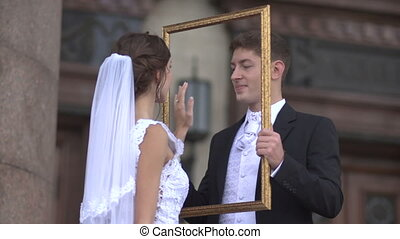 As for the bride groom hand faces in the frame