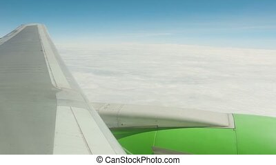 View from the descending aircraft on clouds