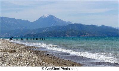 """""""fethiye, turkey mediterranean beach by sea in winter, cloudy day"""""""