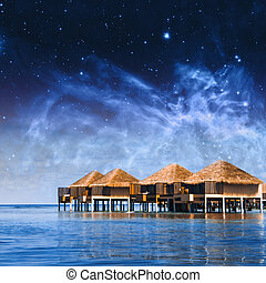 Villa cottages on Maldives. Elements of this image furnished by NASA
