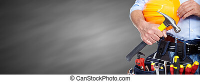 Builder handyman with construction tools. - Builder handyman...