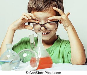 little cute boy with medicine glass isolated wearing glasses...