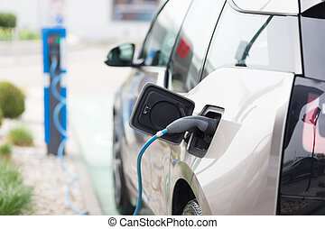 Electric Car in Charging Station - Power supply for electric...