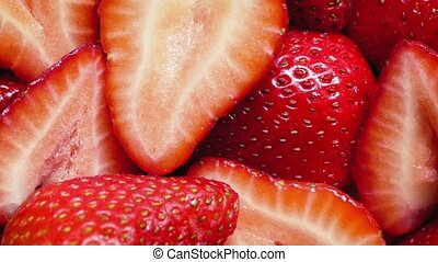 Strawberry Pieces Rotating Closeup - Macro shot of...