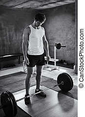 Focussing his energy - Black and white image of a strong...