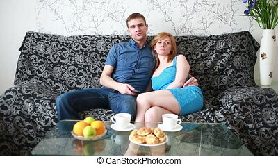 couple preparing to watch a movie - Young couple preparing...