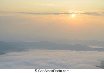 Sunrise over mountain and mist in the morning at sri nan national park thailand