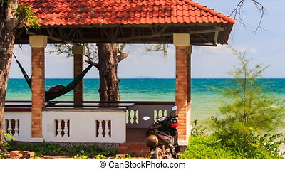 Red Roof Pavilion with Hammock on High Beach Scooter nearby