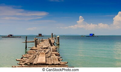 Old Wooden Pier Stretching to Azure Sea Boats at Horizon...