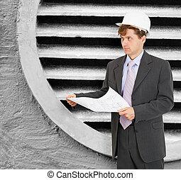 Engineer - designer in helmet with drawings - Engineer -...