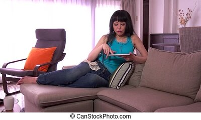 Japanese Lady Using iPad Tablet Pc - Mature Japanese woman...