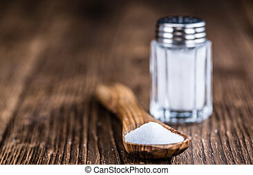 Salt Shaker - Old wooden table with a Salt Shaker (close-up...