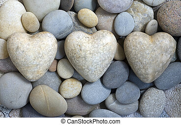 Three hearts - three hearts on gray pebble