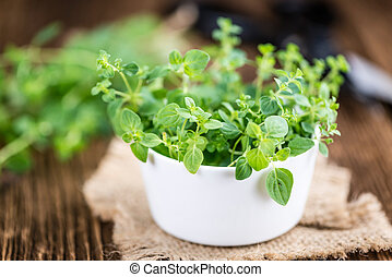 Portion of fresh Oregano (selective focus; close-up shot) on...