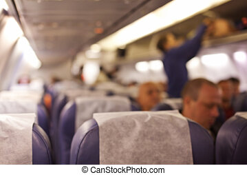 Blurred of interior aircraft with passengers