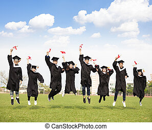 happy young group graduation jumping together