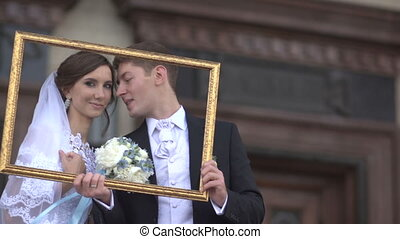 Bride and groom in the picture frame