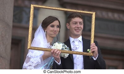 Newlyweds in a picture frame - Wedding day ballet couple...
