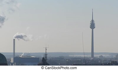 Smokestack and broadcast tower - Smokestack of industrial...