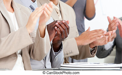 Business team applauding for good results