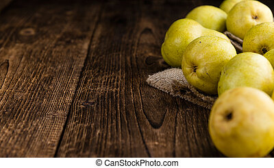 Pears selective focus on an old wooden table close-up shot...