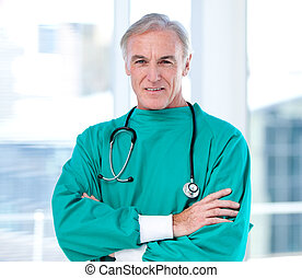 Self-confident male doctor crossing the arms