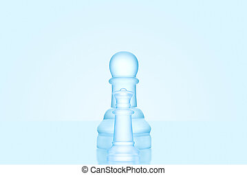Standing alone. - Chess game concept of a single icy frosted...