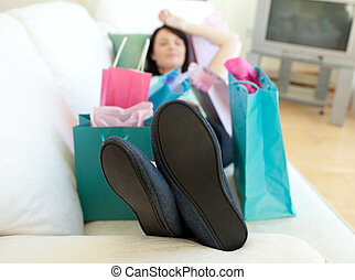 Brunette woman relaxing after shopping - Brunette woman...
