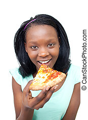 Cheerful young woman eating a pizza
