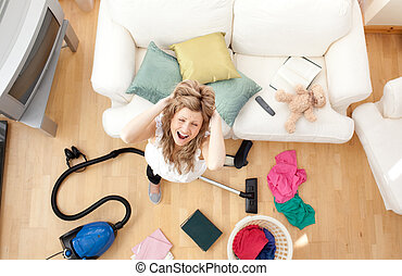 Woman doing housework in living room