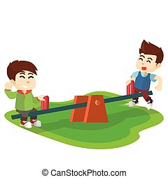Children playing seesaw at park