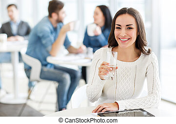 Delighted girl sitting in the cafe
