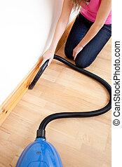 Close-up of a woman vacuuming