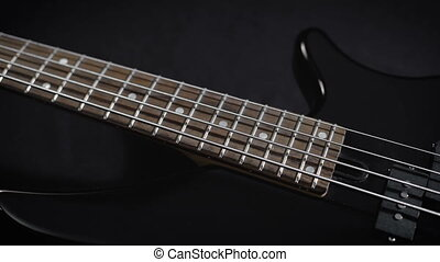 Electric Black Bass Guitar four-stringed instrument