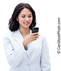 Portrait of an ethnic businesswoman sending a text against a...