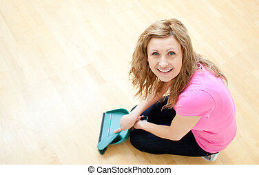 Happy young woman doing housework