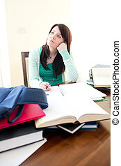 Charming teen girl studying on a desk