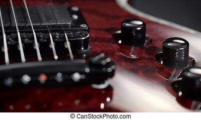 Extreme close-up of an electric guitar. In the frame...