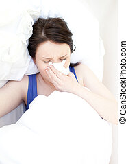 Sick young woman relaxing in her bed - Portrait of a sick...