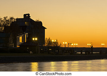 House on lake shore at afterglow - House on lake shore at...